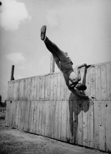 army-recruit-is-in-training-at-the-army-physical-training-school-brisbane-1942